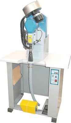 Foto de Máquinas automáticas con brazo vertical