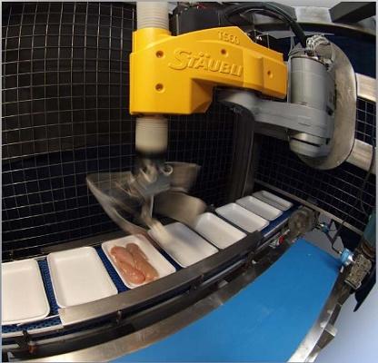 Foto de Robots para la carga de pechugas de pollo