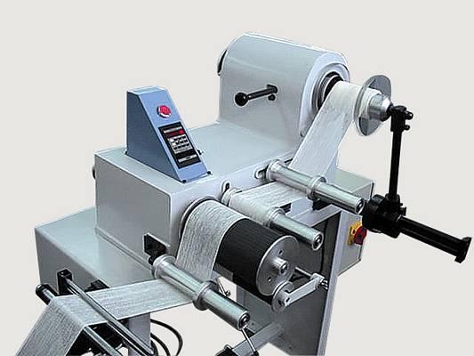 Foto de Máquina para el medido y enrollado de vendas y gasas médicas