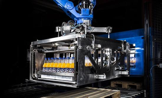 Foto de Sistema para la manipulación con robots de botellas de bebidas