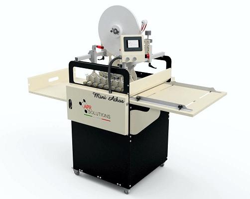 Foto de Equipos semiautomáticos para la aplicación industrial de cinta a doble cara