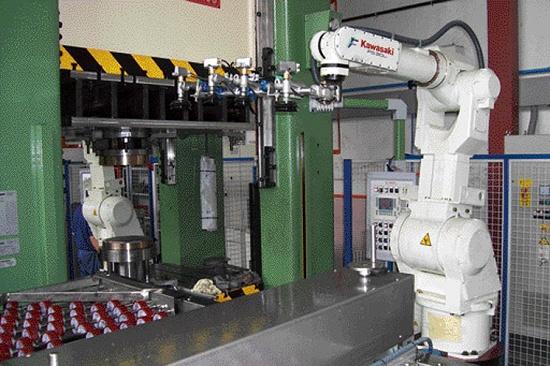 Foto de Robot para carga y descarga de máquinas