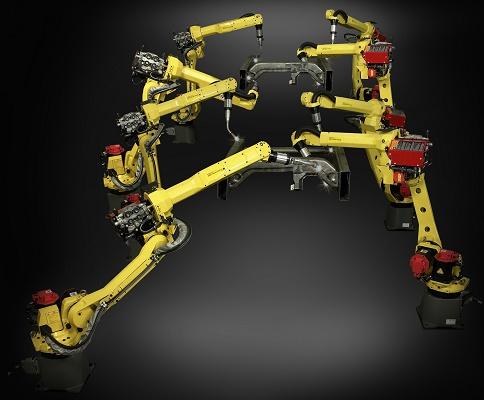 Foto de Robot de soldadura de brazo largo y hueco